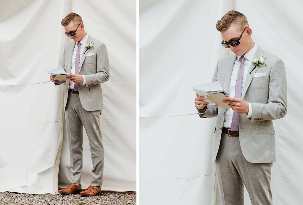 Stone Mountain Lodge Wedding in Lyons Colorado Groom reading letter from bride before ceremony
