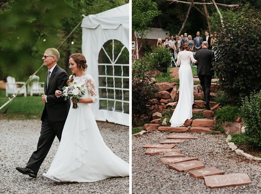 Bride and her father walks down the aisle at Stone Mountain Lodge wedding in Lyons
