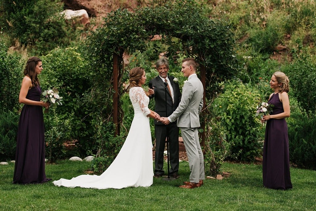 Stone Mountain Lodge Wedding in Lyons Colorado bride and groom with officiant maid of honor and best woman