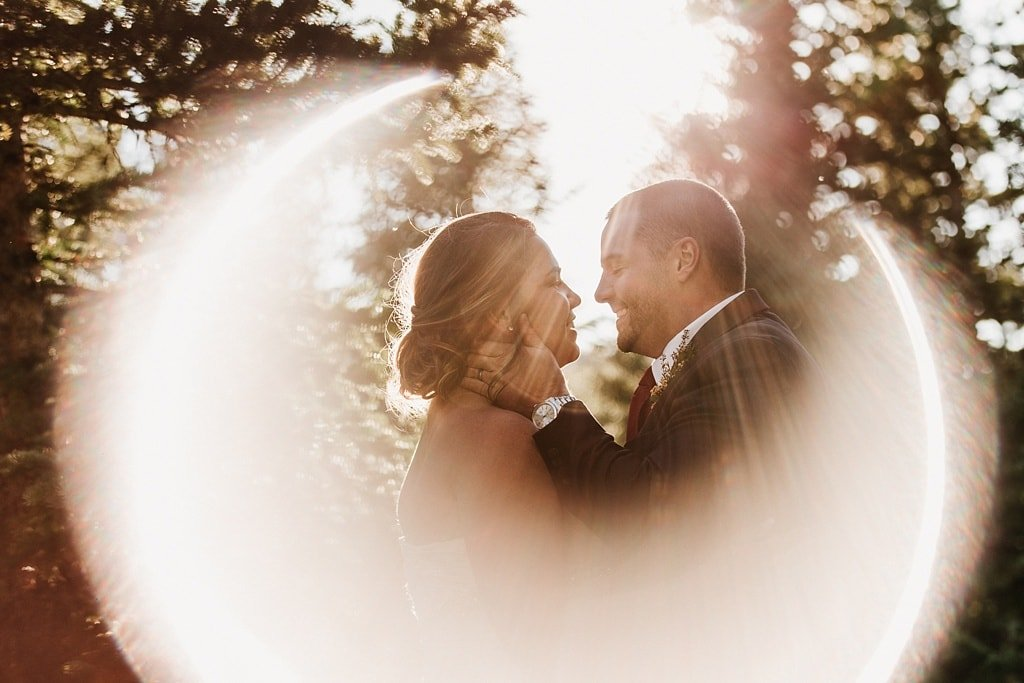 Lunch Rock Winter Park Resort Wedding Colorado Ring of Fire sunflare bride and groom portrait