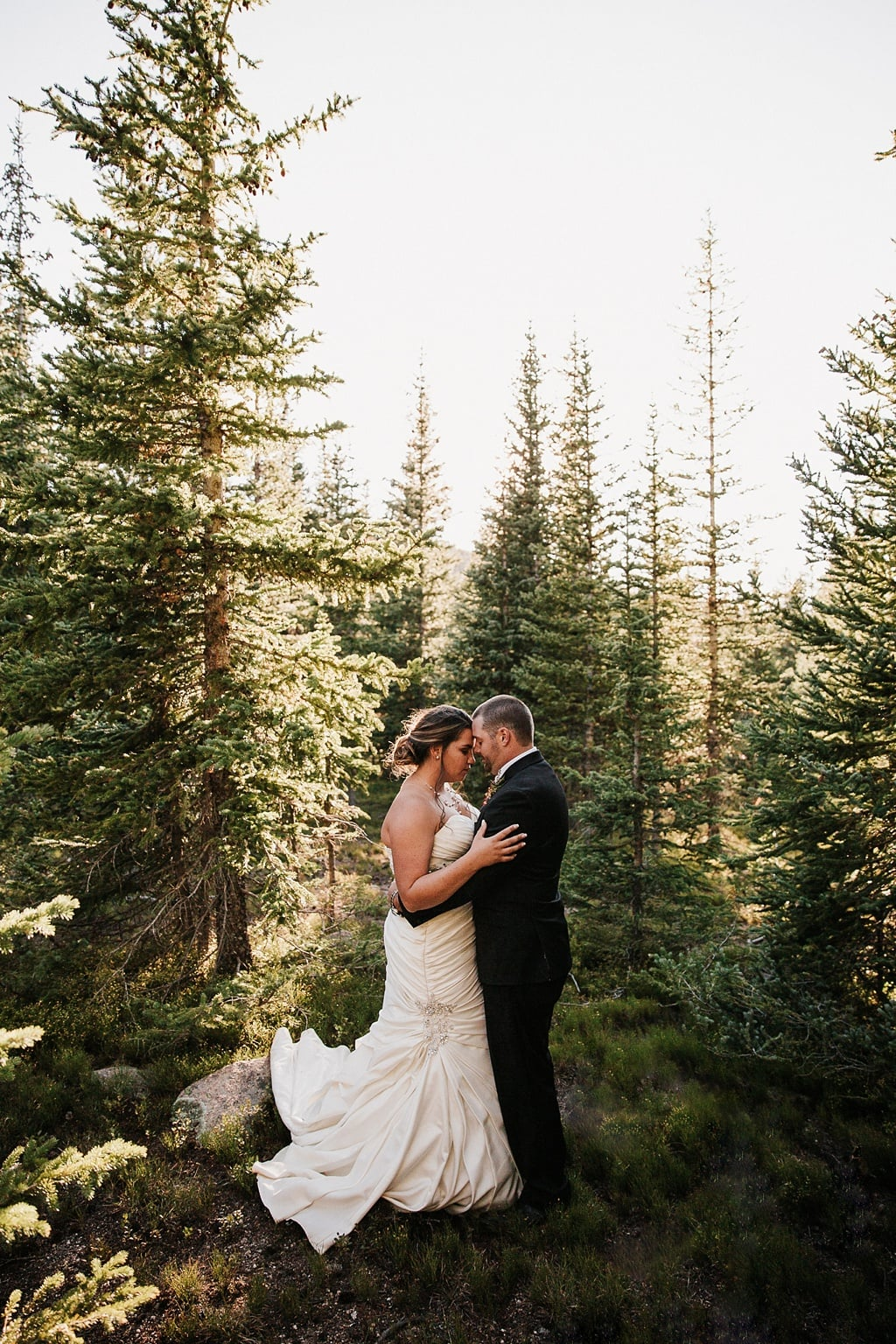 Lunch Rock Winter Park Resort Wedding Colorado Bride and groom quiet moment in trees woods forest