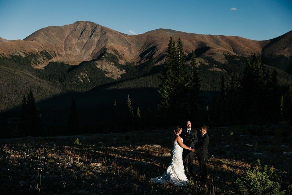 Lunch Rock Winter Park Resort Wedding Colorado Outdoor Mountain Elopement Ceremony bride and groom holding hands