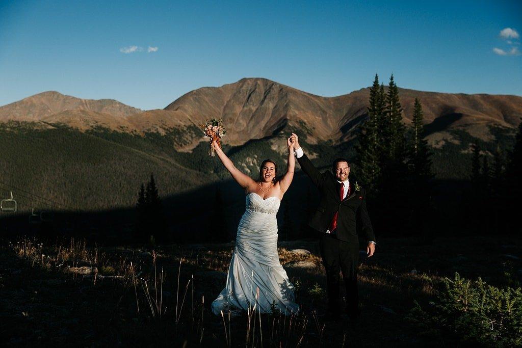 Lunch Rock Winter Park Resort Wedding Colorado Outdoor Mountain Elopement Ceremony Bride and groom celebrating after ceremony