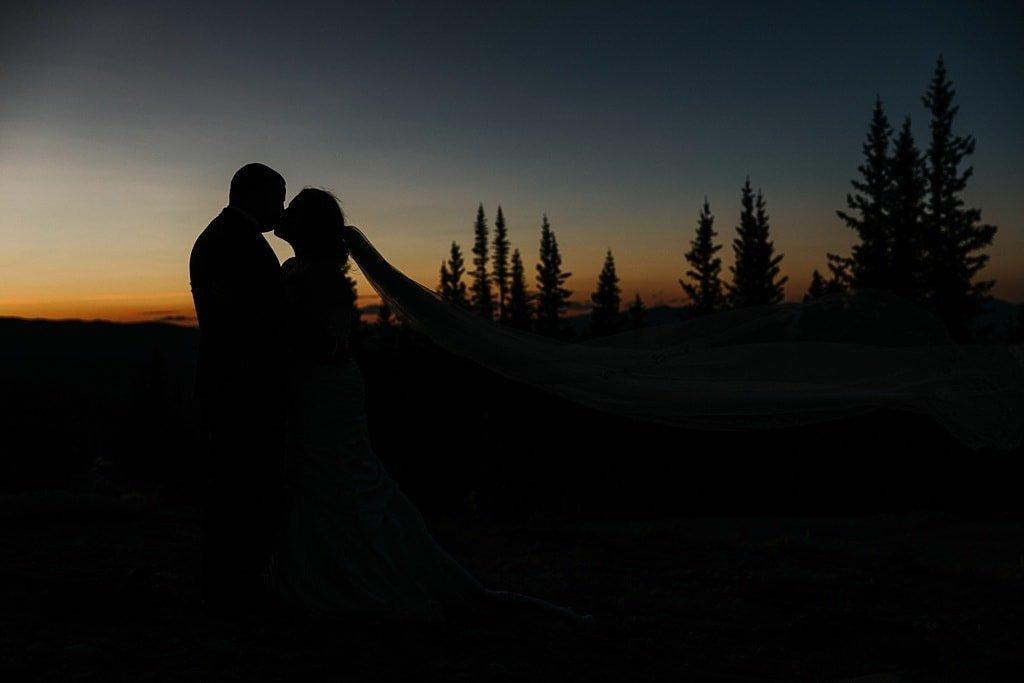 Lunch Rock Winter Park Resort Wedding Colorado Outdoor Mountain Elopement Ceremony sunset portrait silhouette bride and groom