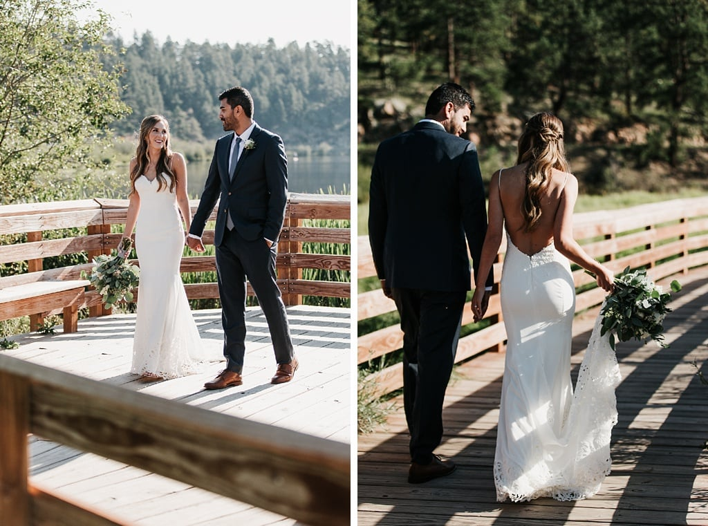 Evergreen Lake House Brunch Wedding Colorado Bride and groom portraits walking on board walk by lake