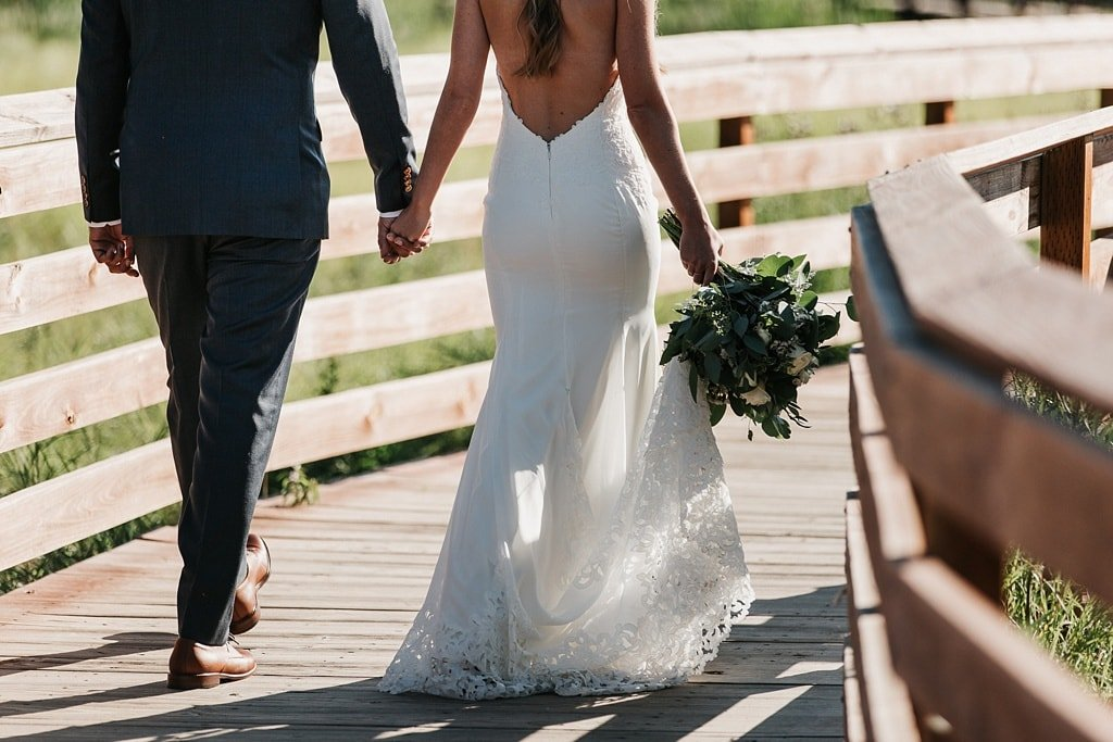 Evergreen Lake House Brunch Wedding Colorado bride and groom walking away from camera