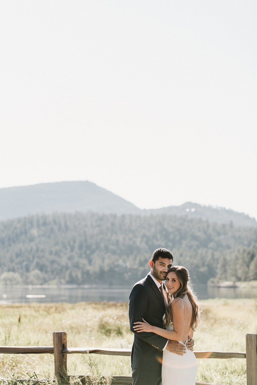 Evergreen Lake House Brunch Wedding Colorado bride and groom portrait photography overlooking mountains and lake