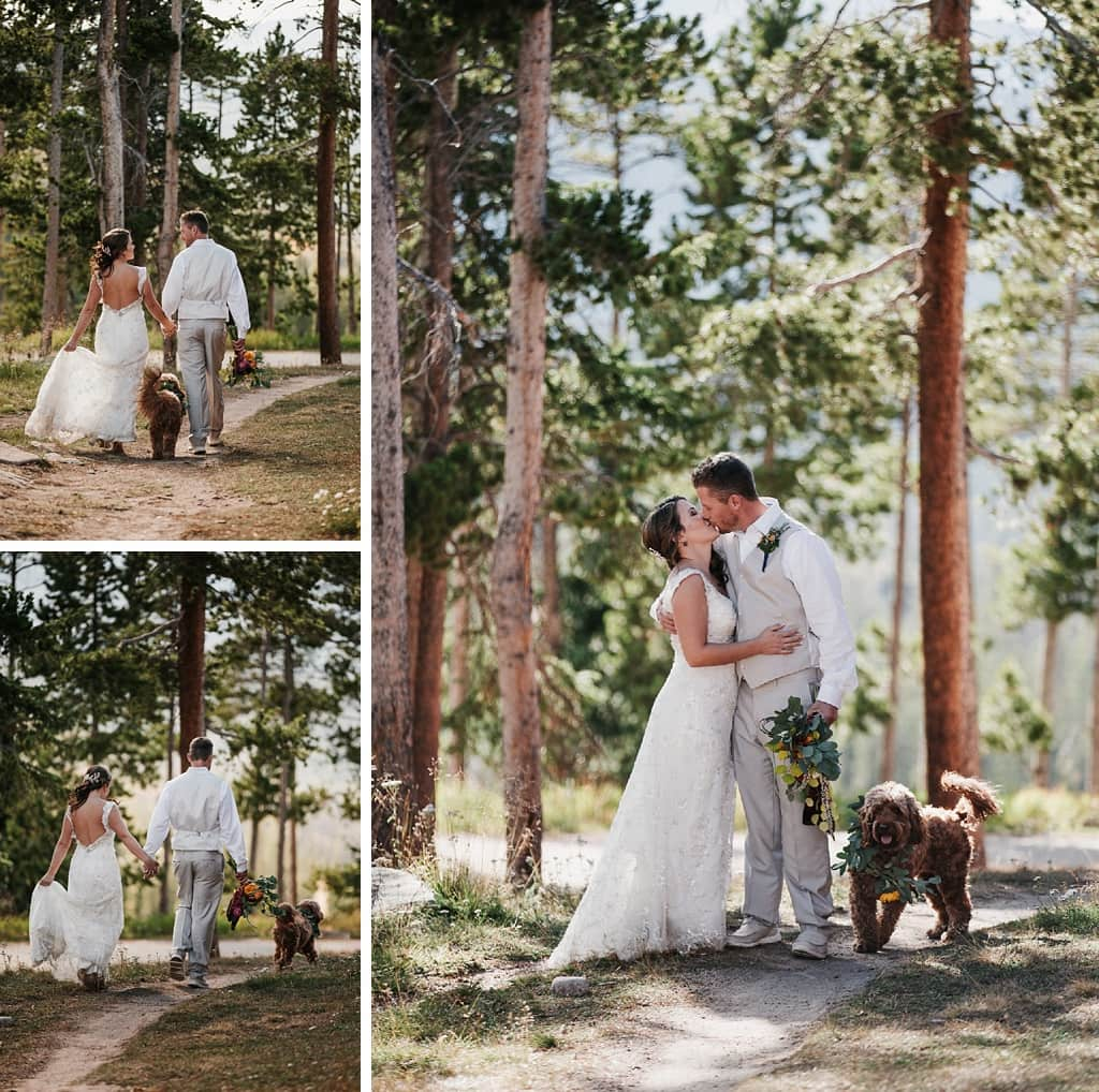Sunspot Lodge Winter Park Resort Wedding bride and groom walking in woods with dog