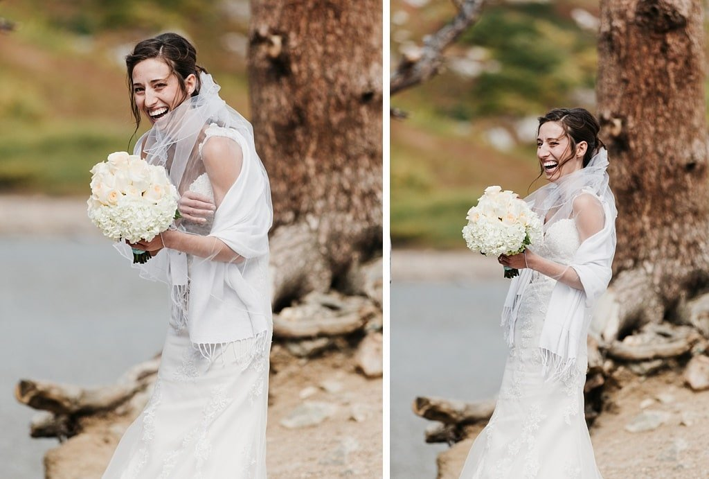 Bride laughing in the wind during her St. Mary's Glacier hiking elopement wedding