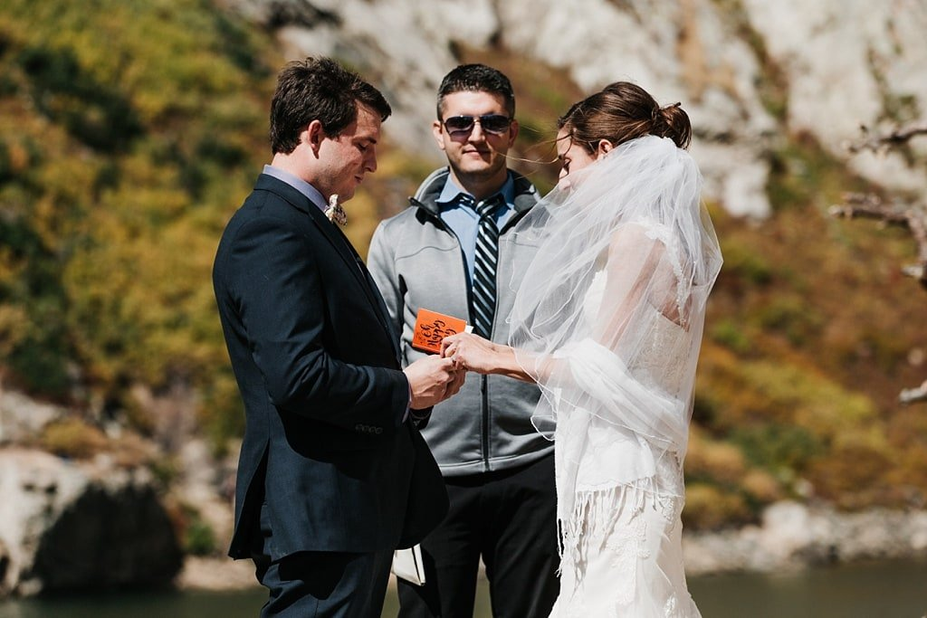 Bride and groom exchanging vows at St. Mary's Glacier, Colorado for hiking elopement