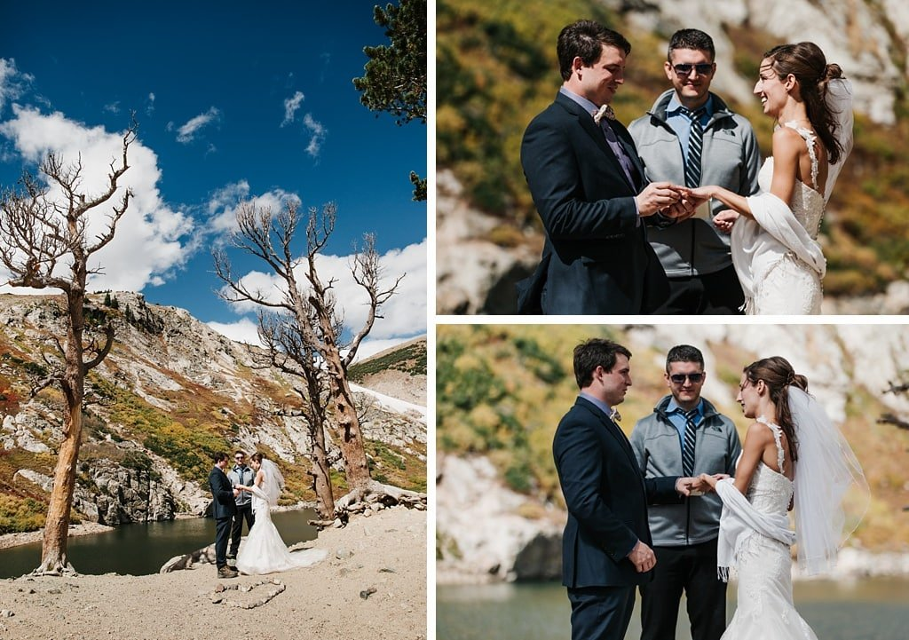Bride and groom exchanging wedding rings at St. Mary's Glacier elopement hiking wedding Colorado