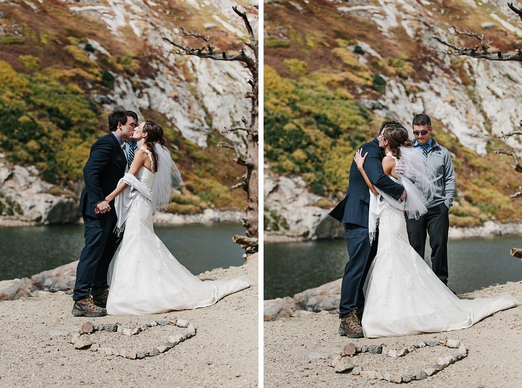 Bride and groom first kiss at St. Mary's Glacier hiking elopement wedding Colorado
