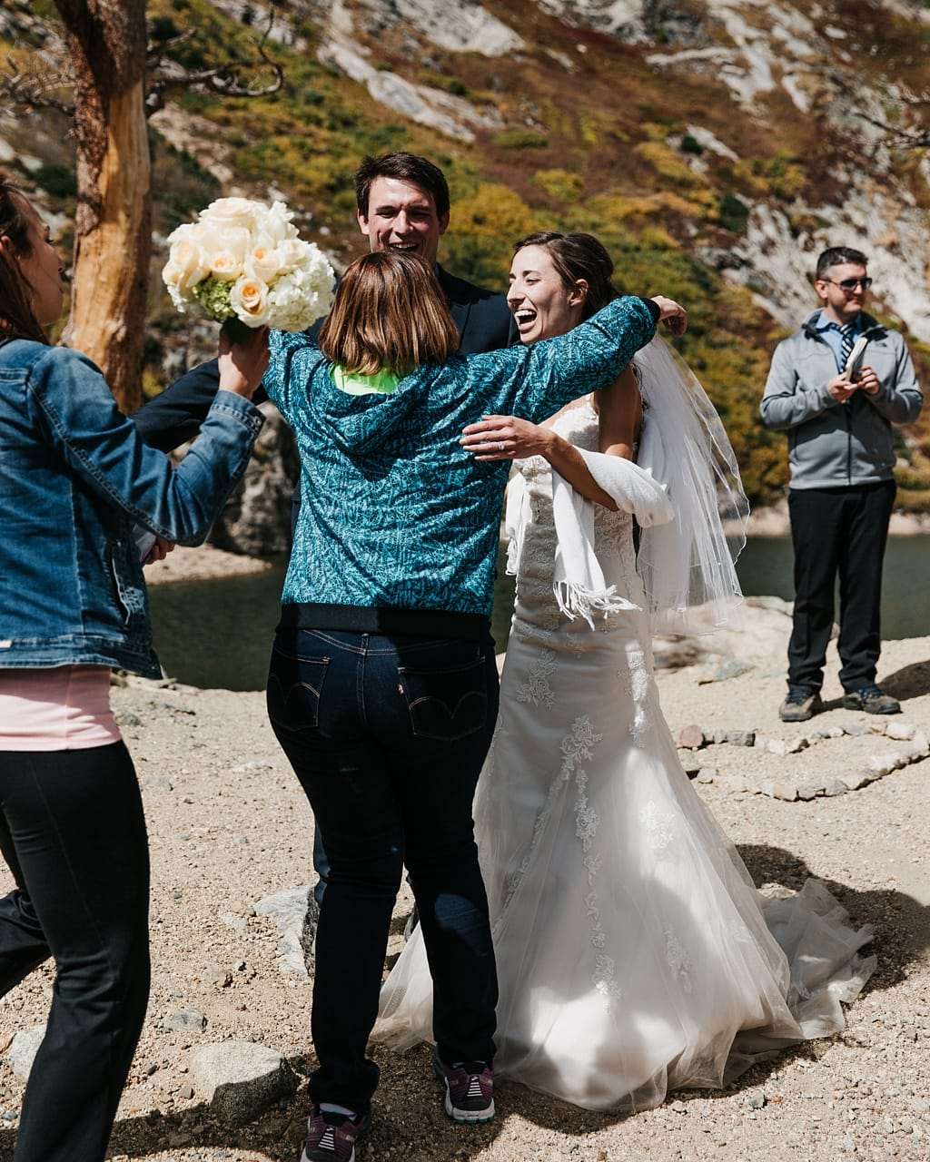 Friends congratulation bride and groom after St. Mary's Glacier hiking elopement ceremony
