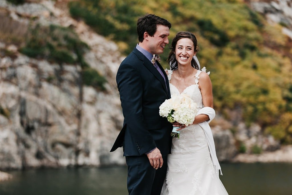 Bride and groom portraits after outdoor ceremony at St. Mary's Glacier elopement