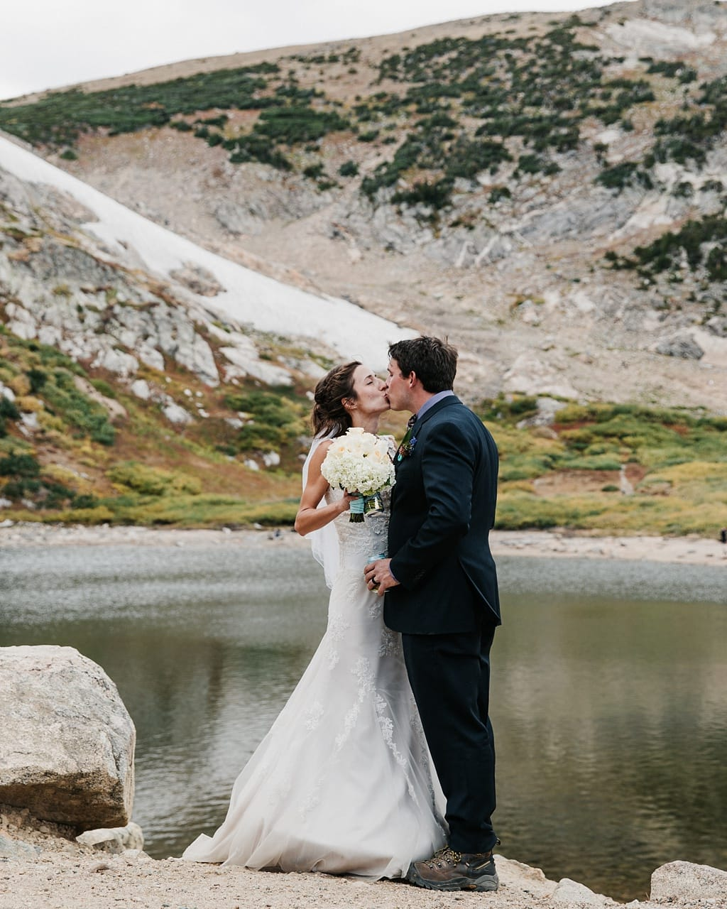 Bride and groom portraits after outdoor ceremony at St. Mary's Glacier elopement hiking wedding