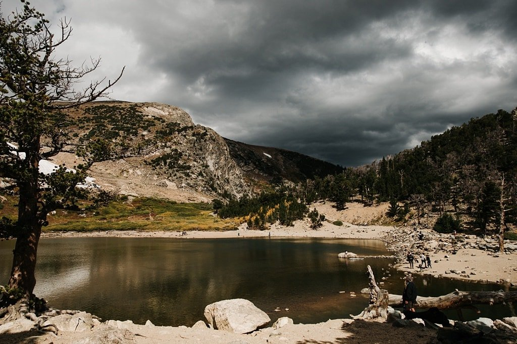 Stormy weather and dark clouds come in at St. Mary's Glacier elopement hiking wedding Colorado