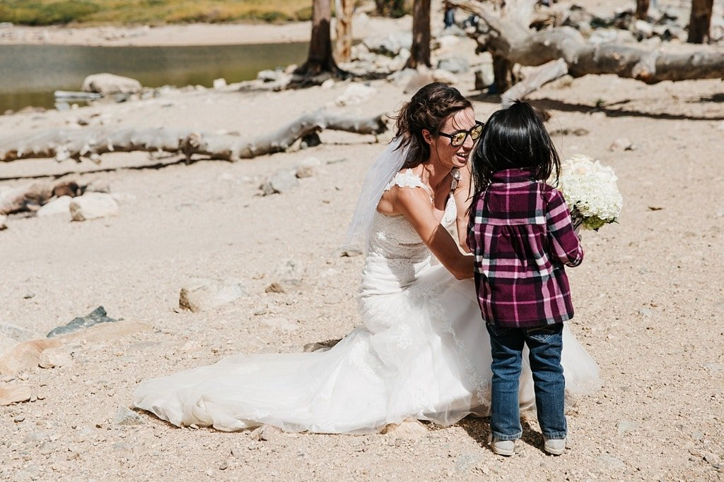 Bride with little girl who thought bride was a princess