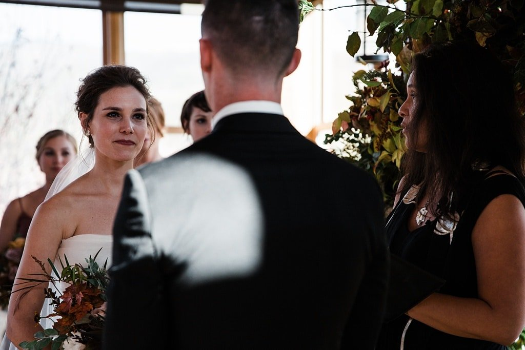 Devil's Thumb Ranch winter wedding indoor ceremony Colorado