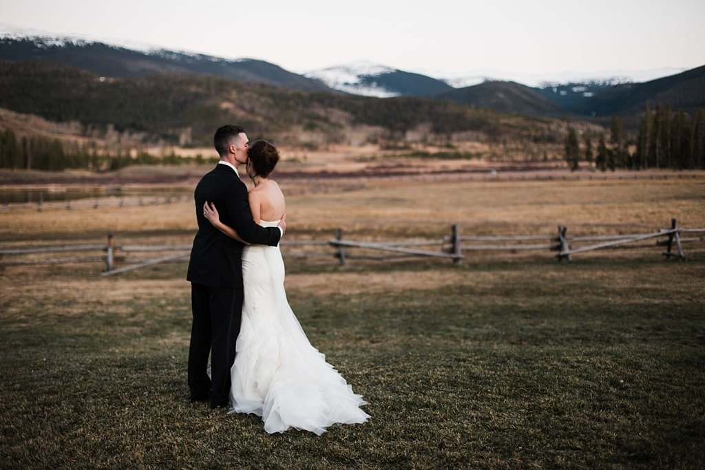 Bride and groom portraits at sunset at Devil's Thumb Ranch in Tabernash Colorado, classic photojournalistic wedding photography, Vera Wang dress, alpenglow