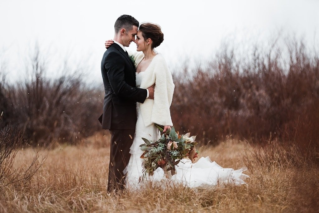Bride and groom portraits in winter with Vera Wang wedding dress and bouquet by Yonder House florals Colorado