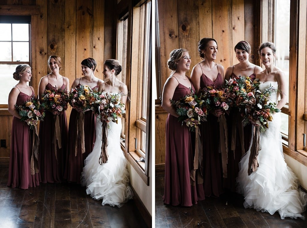 Bride with bridesmaids at Devil's Thumb Ranch muted wine colored bridesmaid dresses, wedding gown by Vera Wang, bouquets by Yonder House Colorado bridesmaid dresses by Jenny Yoo