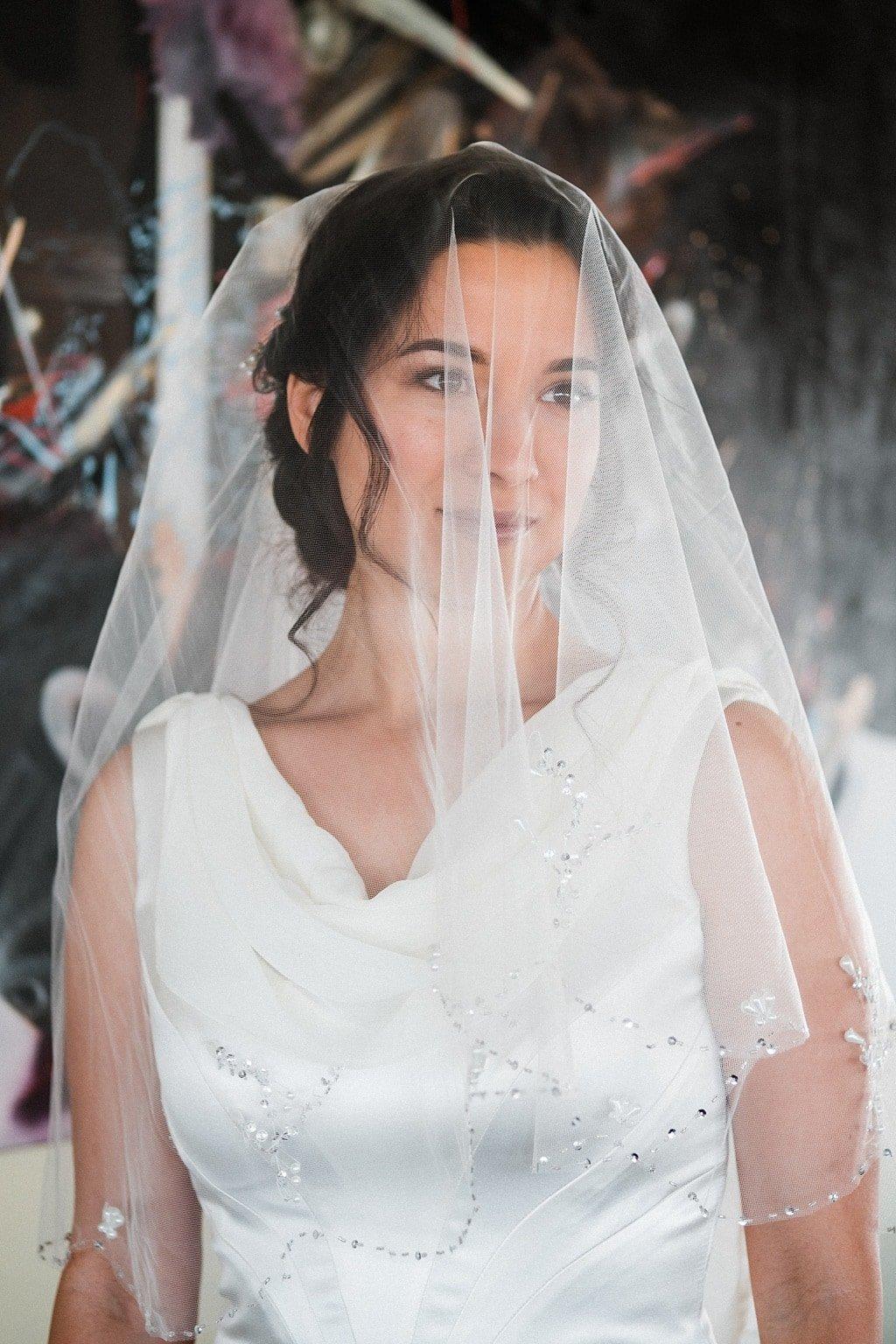 Bride wearing veil getting ready at Flagstaff House wedding venue restaurant Boulder Colorado