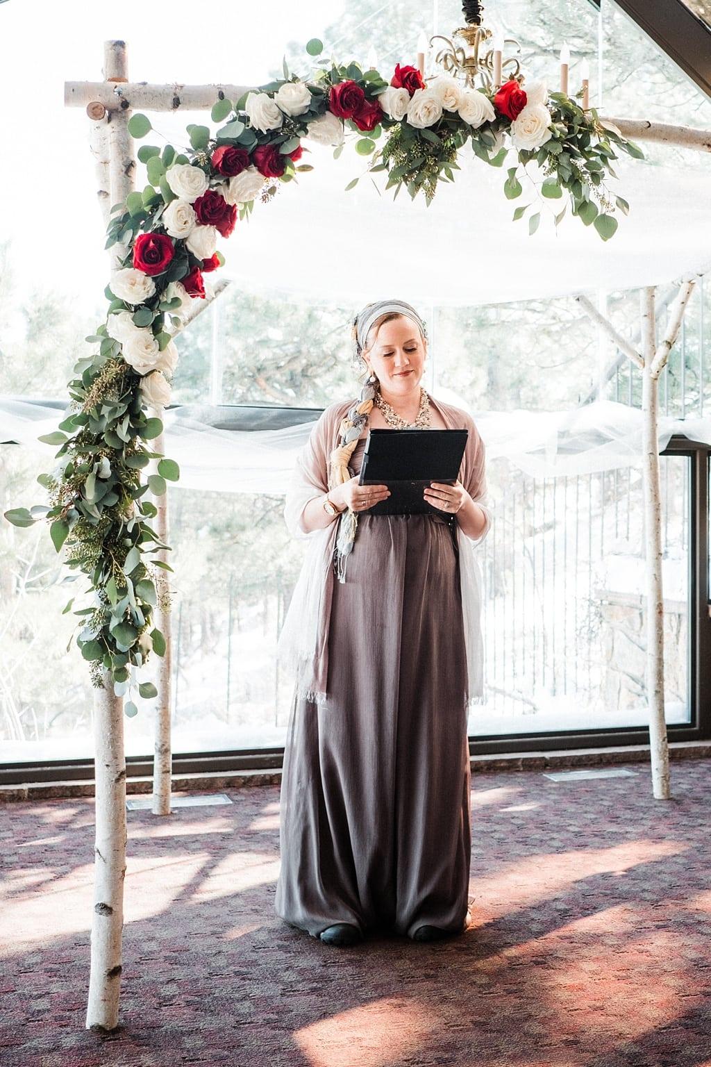 Officiant under chuppah at Flagstaff House wedding venue Boulder Colorado