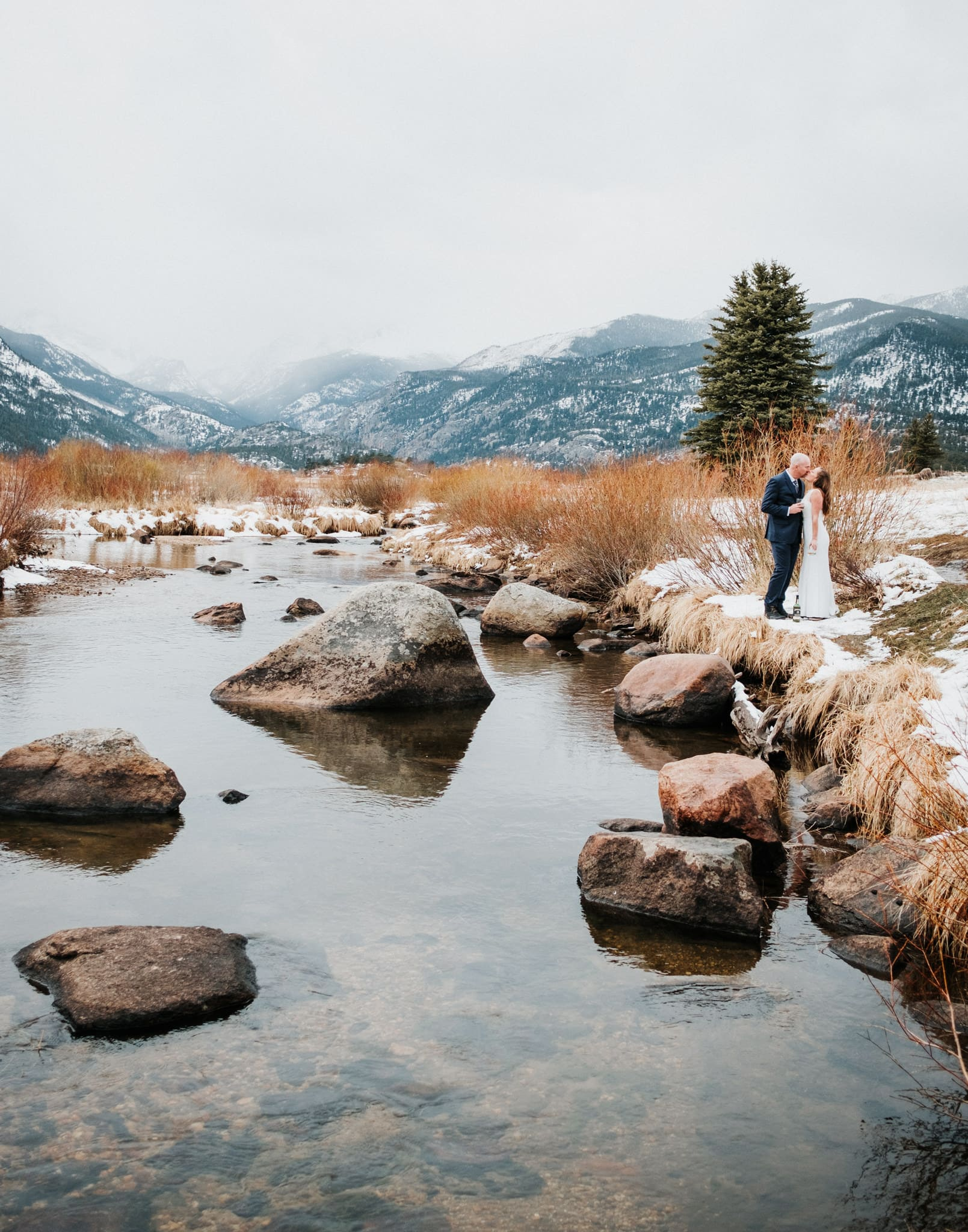 Moraine Park hiking elopement, Rocky Mountain National Park wedding photographer, bride and groom drinking whiskey