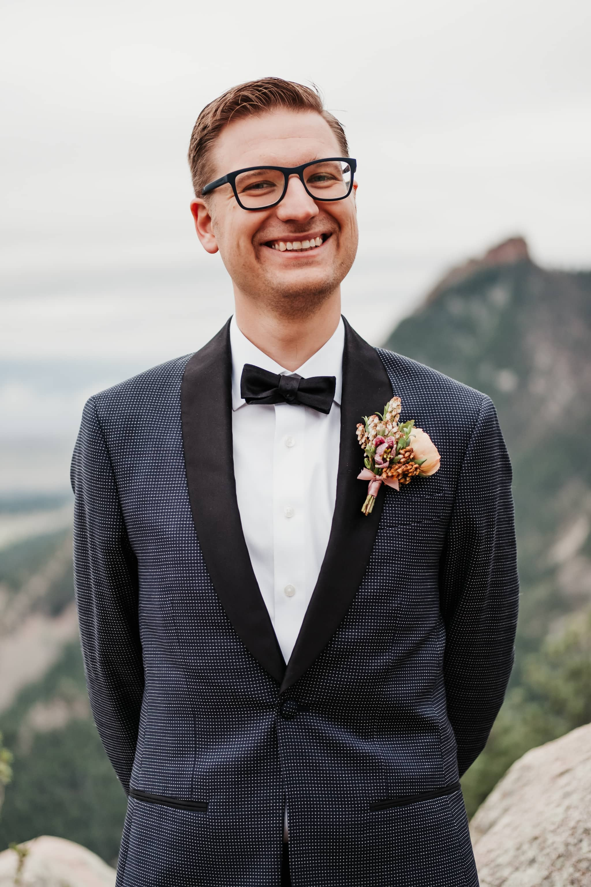 Groom wearing tux from The Black Tux, boutonniere by Fawns Leap