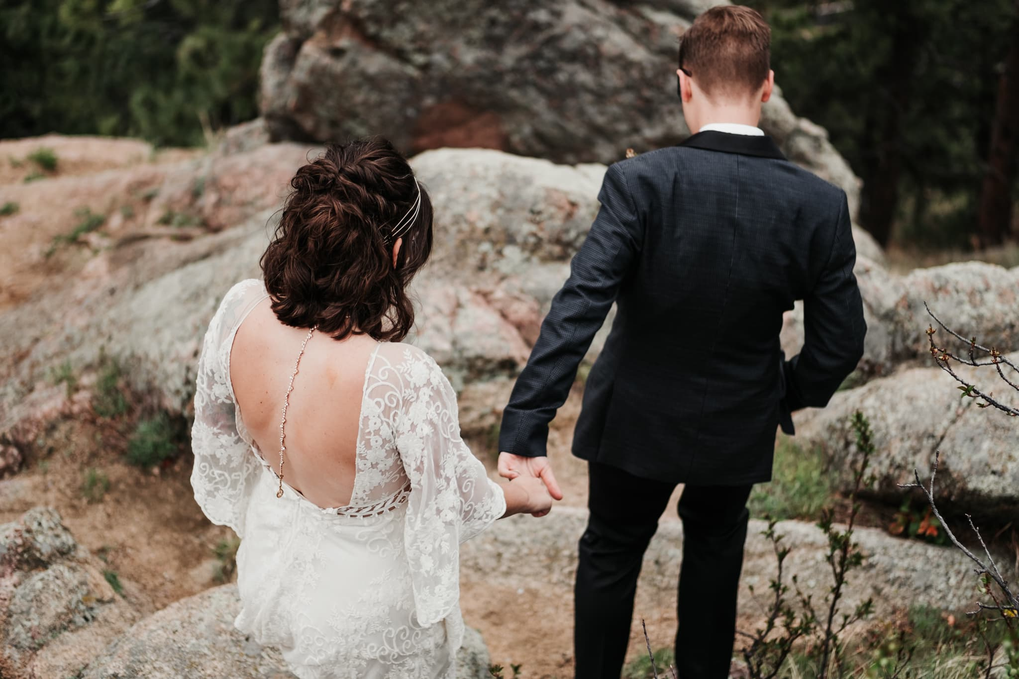 Hiking elopement photography, bride and groom hiking a mountain, Colorado wedding photographer