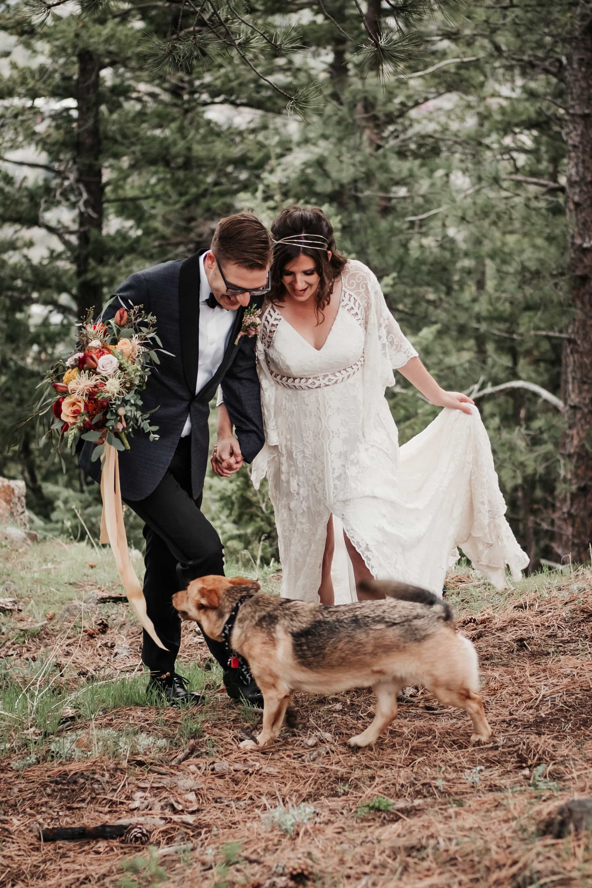 Bride and groom petting their dog, dog at wedding, Colorado elopement photographer