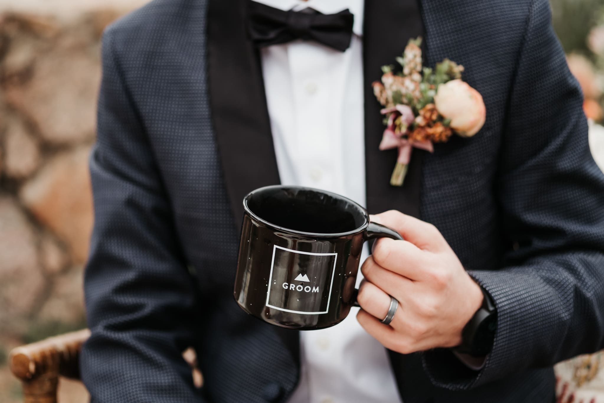 Groom holding coffee mug by Rocky Mountain Bride