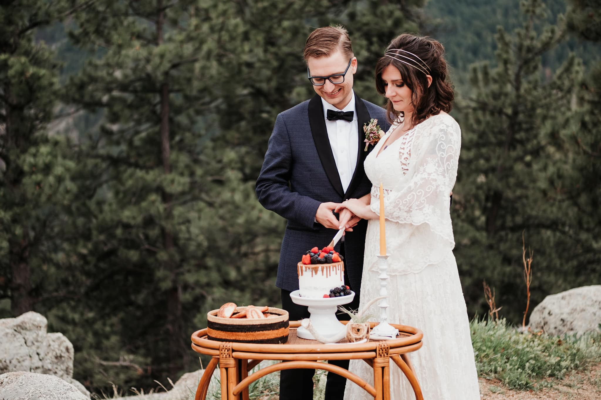 Bride and groom cutting cake at outdoor elopement ceremony