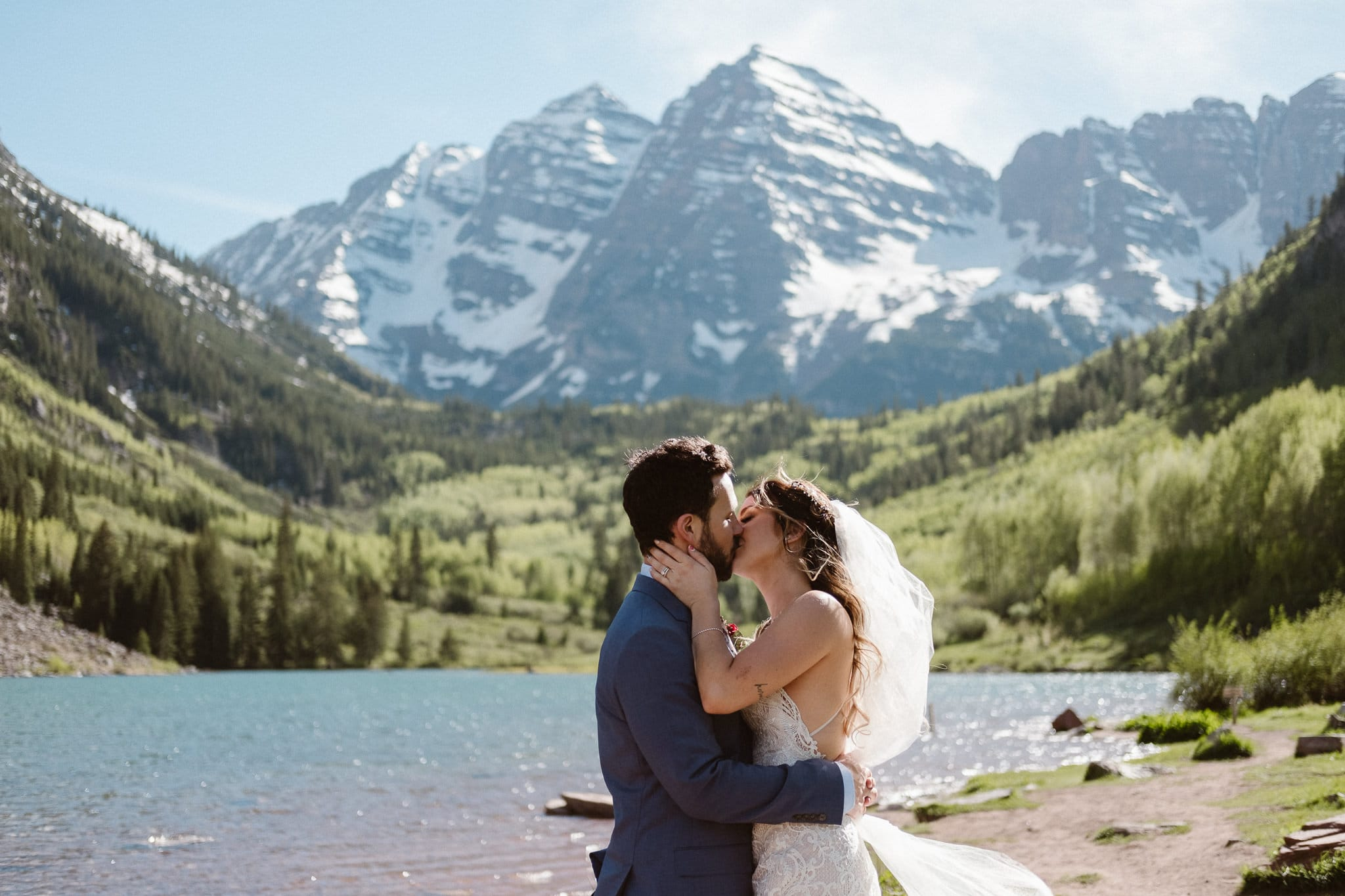 Maroon Bells Amphitheater elopement, Aspen wedding photographer, Colorado adventure elopement, bride and groom kissing at alpine lake