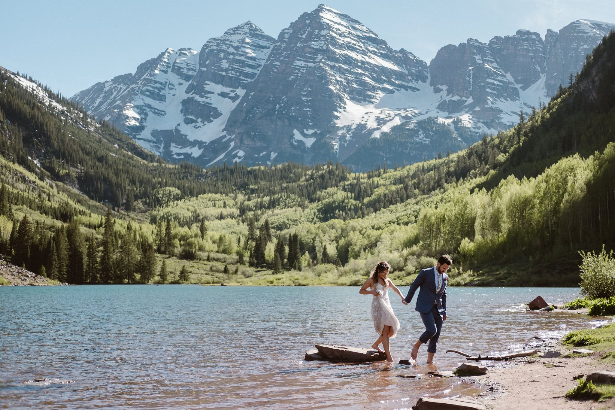 Maroon Bells Amphitheater elopement, Aspen wedding photographer, Colorado adventure elopement, bride and groom wading through alpine lake