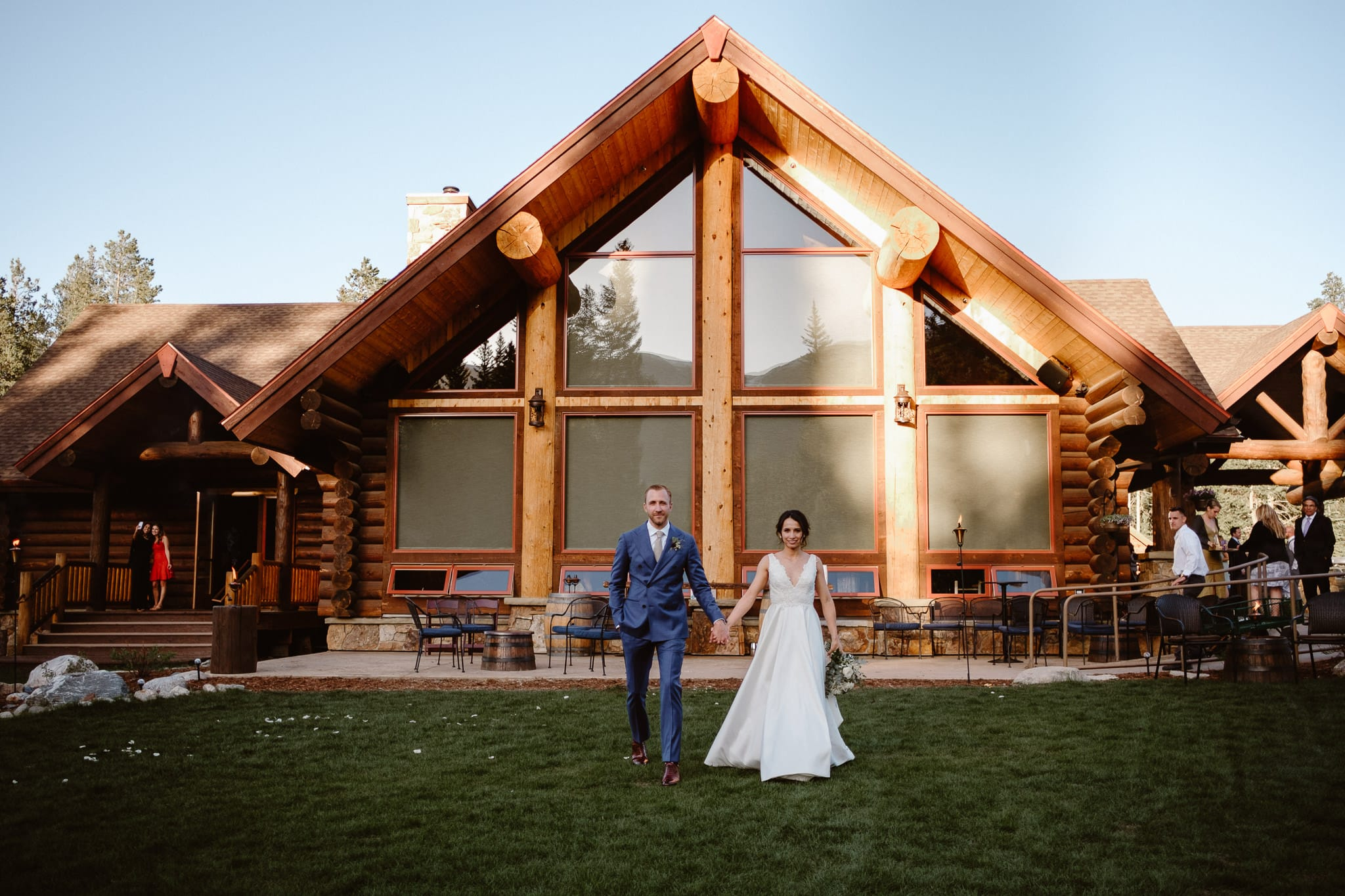 Breckenridge Nordic Center Wedding Photographer, bride and groom portraits outside log cabin