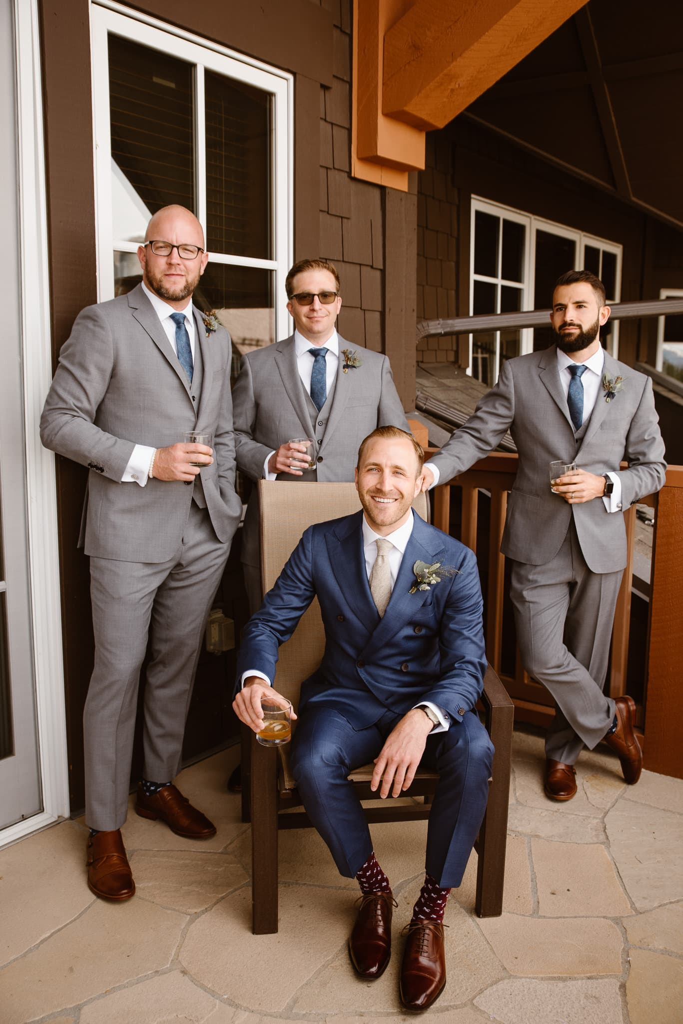 Groom with groomsmen at One Ski Hill Hotel before Breckenridge Nordic Center wedding
