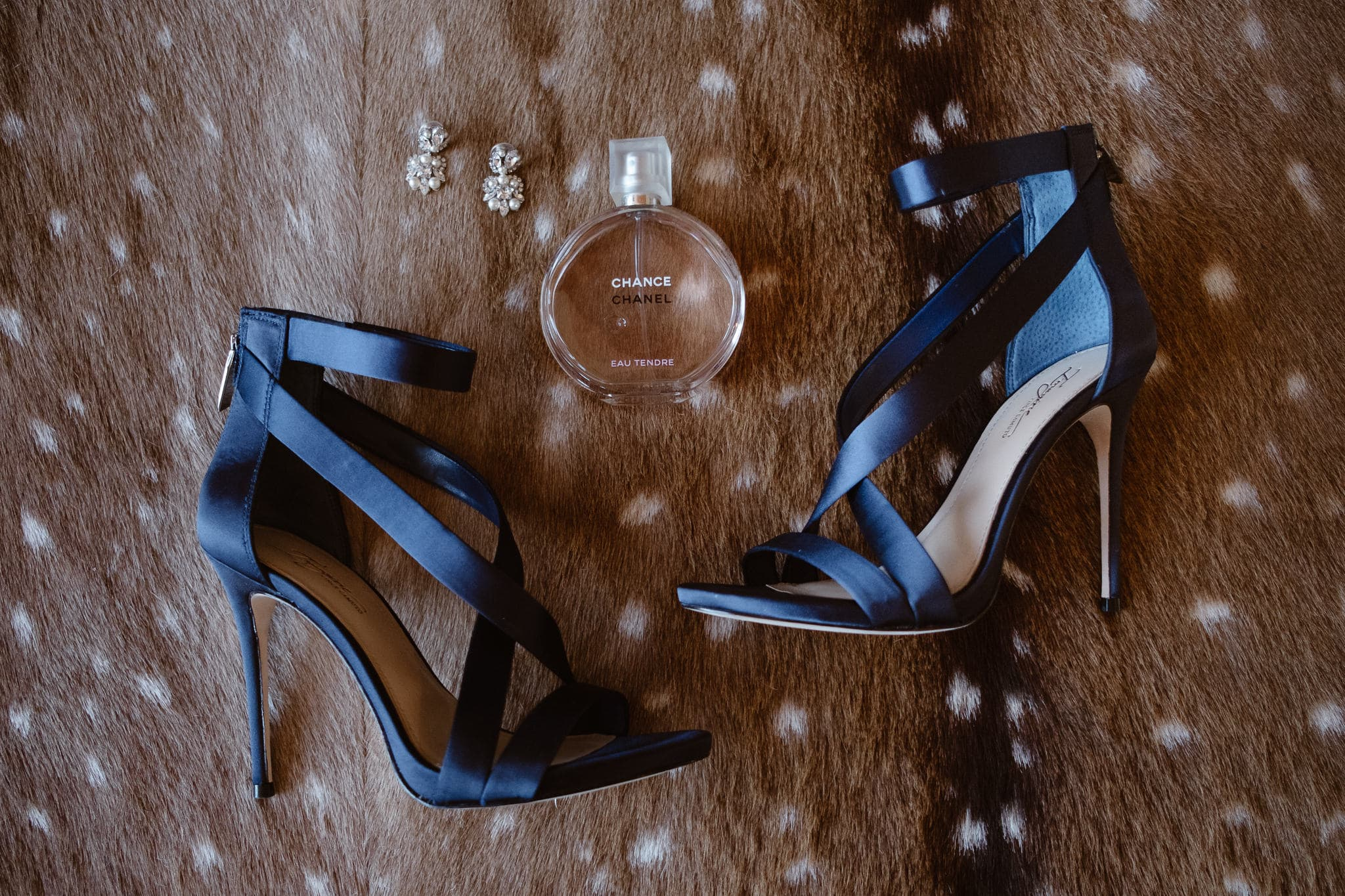 Bride's satin blue wedding shoes stilettos and Chanel no. 5 wedding details, Breckenridge Nordic Center wedding photographer