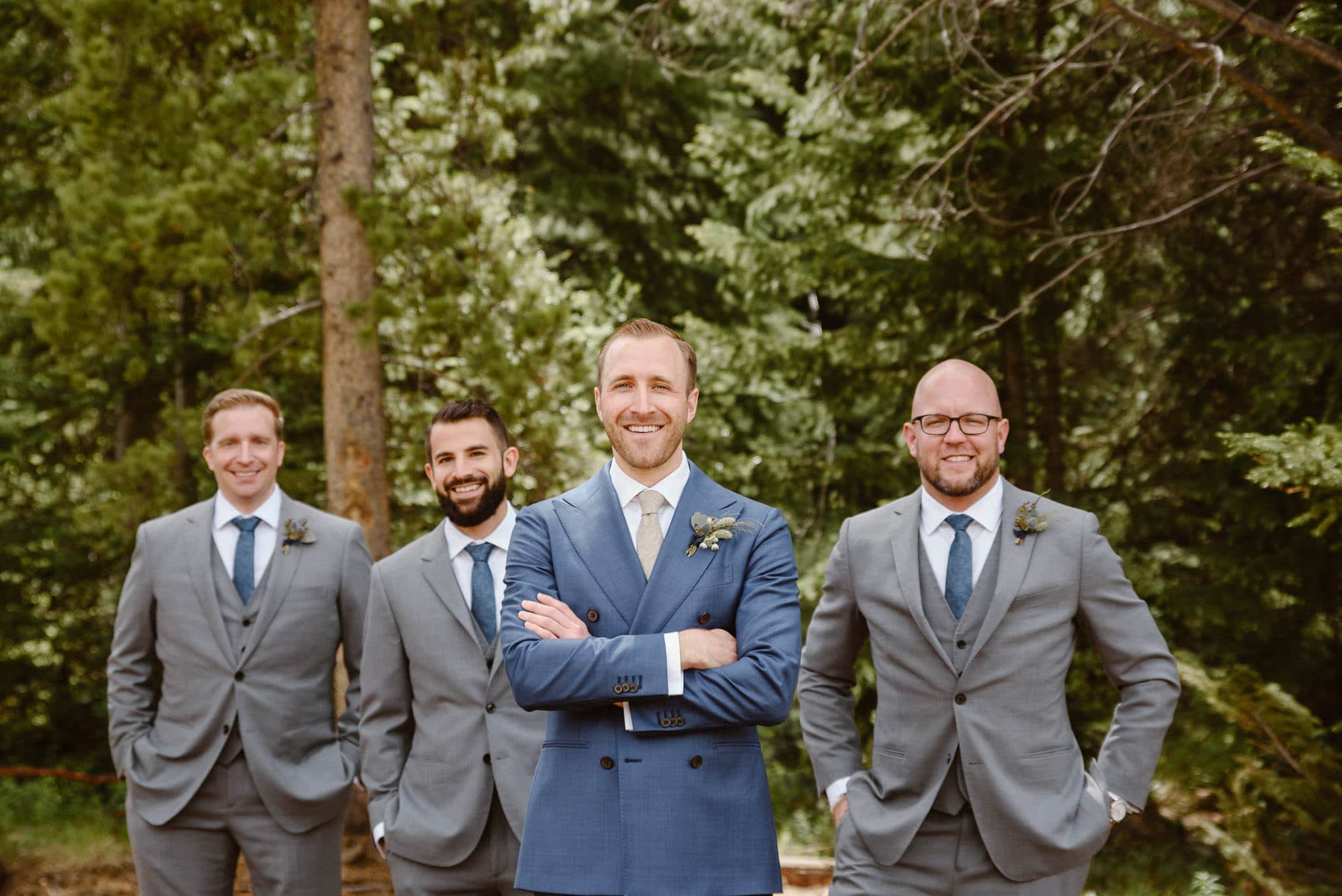 Groom and groomsmen in the woods at Breckenridge Nordic Center wedding, Summit County wedding photographer