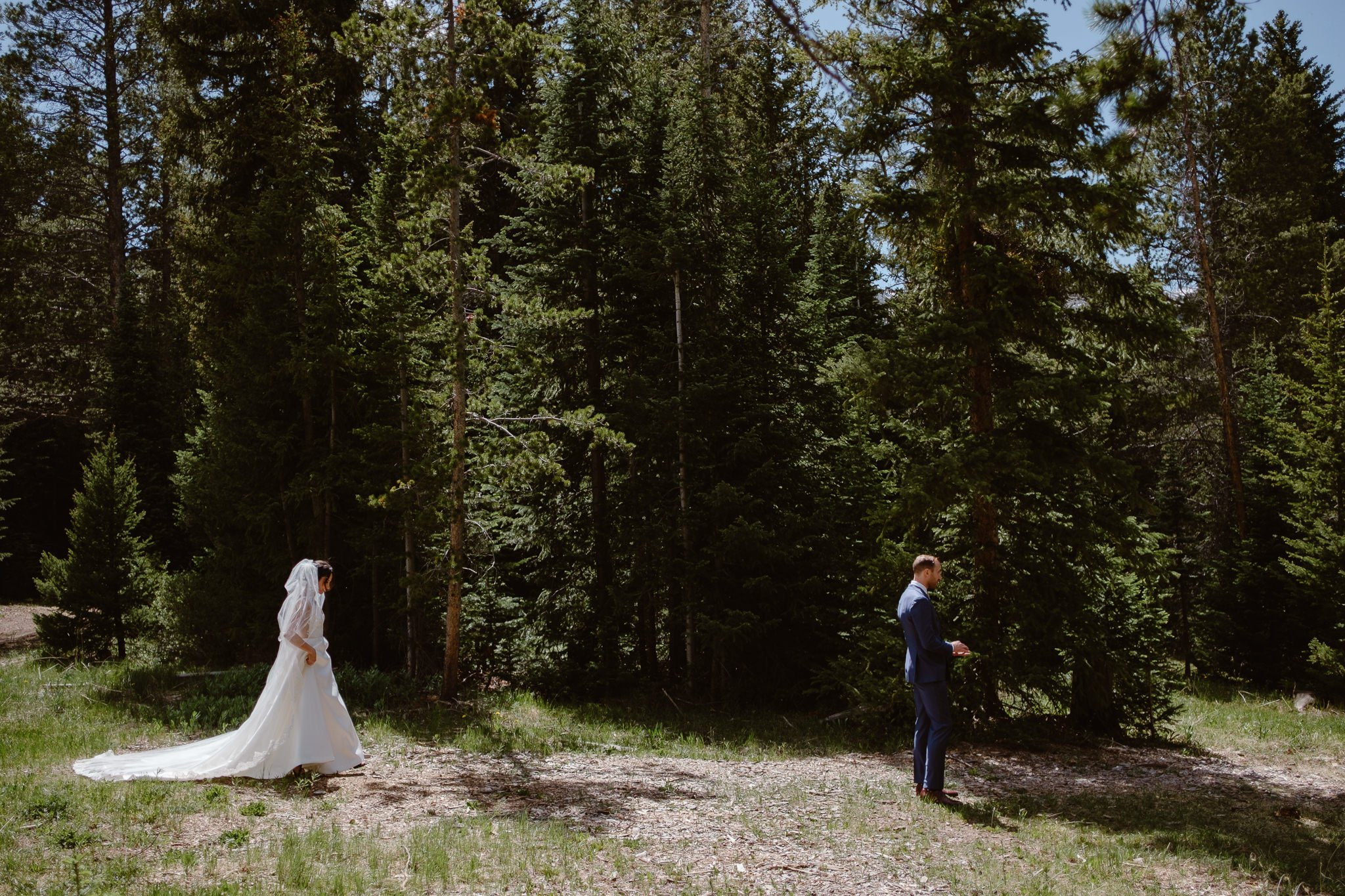 Bride and groom first look in the woods at Breckenridge Nordic Center wedding, Summit County wedding photographer