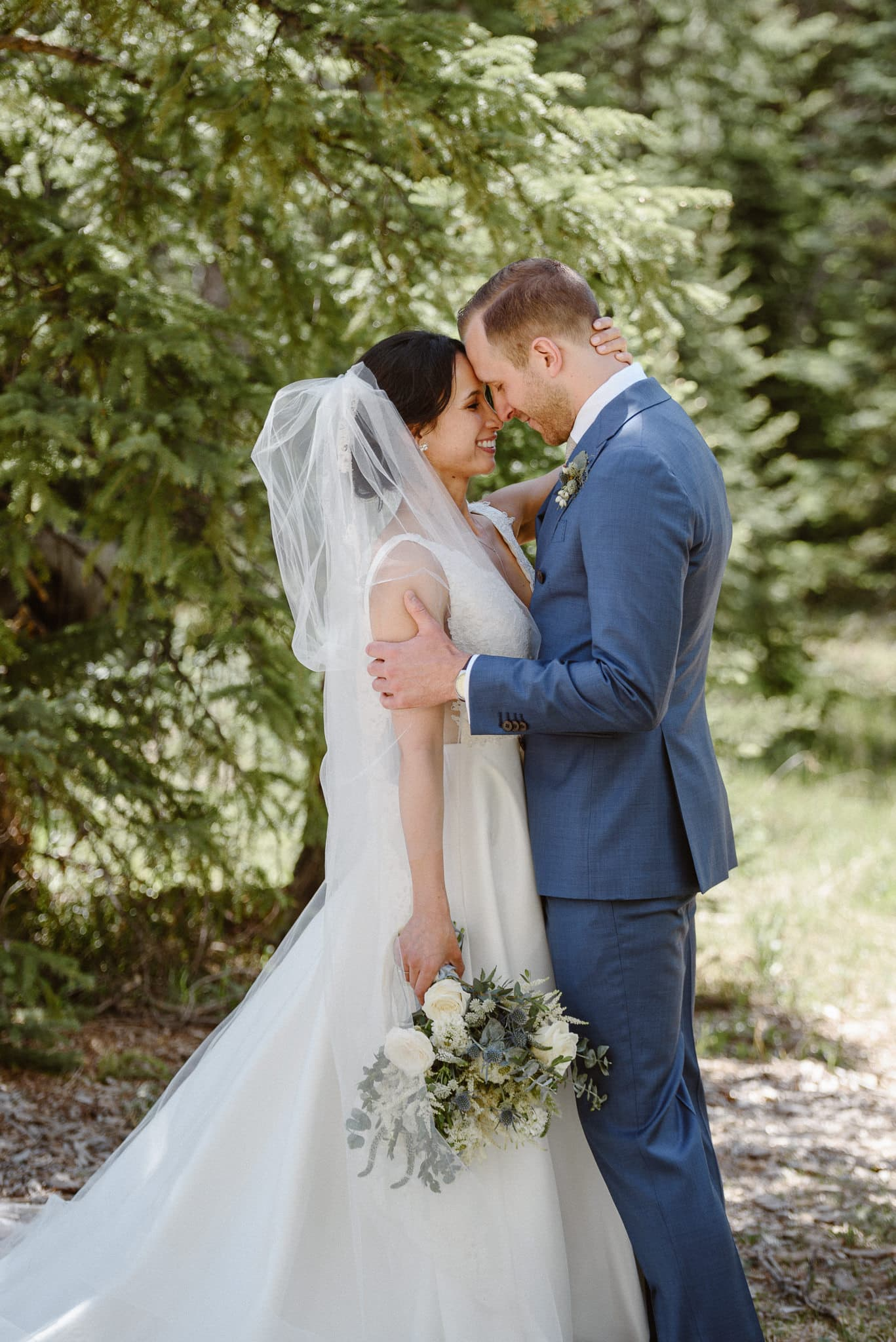Bride and groom portraits in the woods at Breckenridge Nordic Center wedding, Summit County wedding photographer
