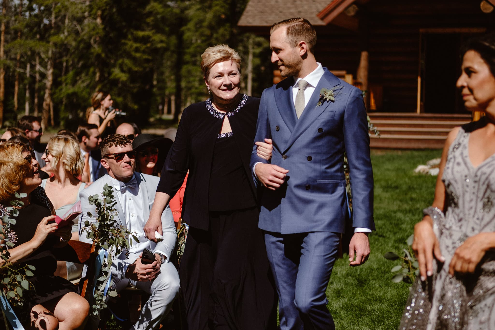 Groom walking down the aisle with his mother at Breckenridge Nordic Center wedding ceremony, Summit County wedding photographer