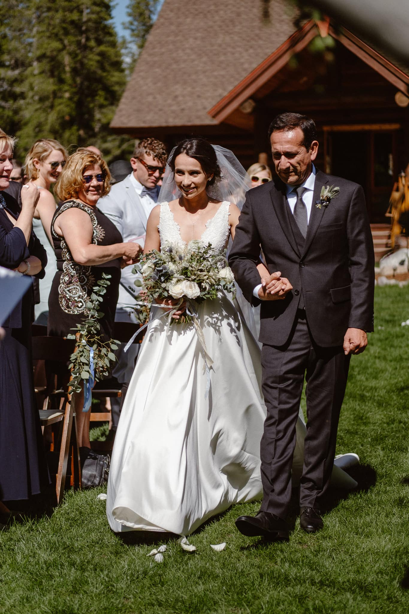 Bride and her father walking down the aisle at Breckenridge Nordic Center wedding ceremony, Summit County wedding photographer