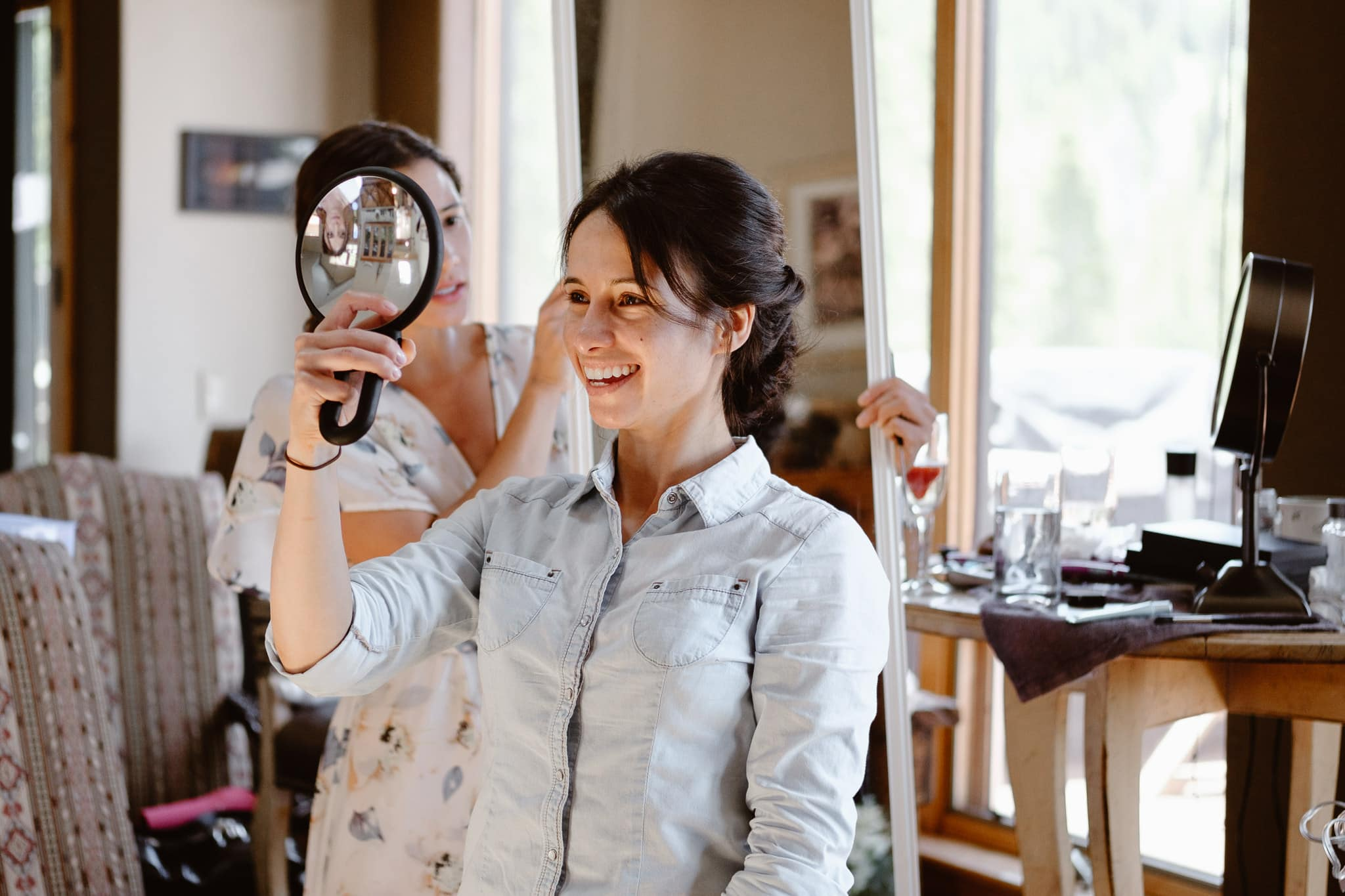 Bride getting ready for Breckenridge Nordic Center wedding, hair and makeup by Naomi Robles