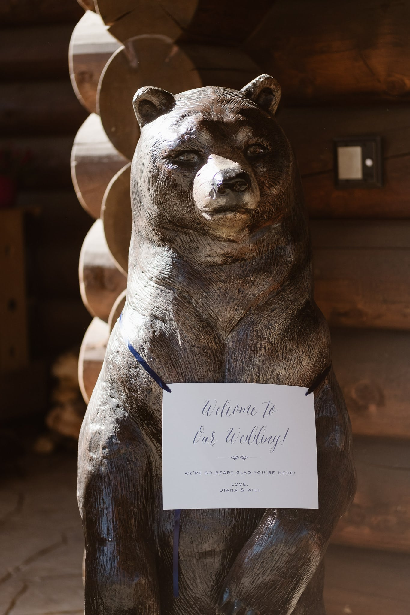 Wooden bear with welcome sign at Breckenridge Nordic Center wedding