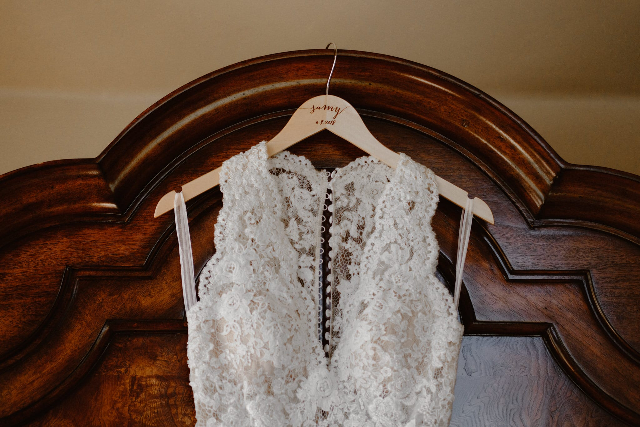 Lace body suit wedding dress on custom hanger with bride's name