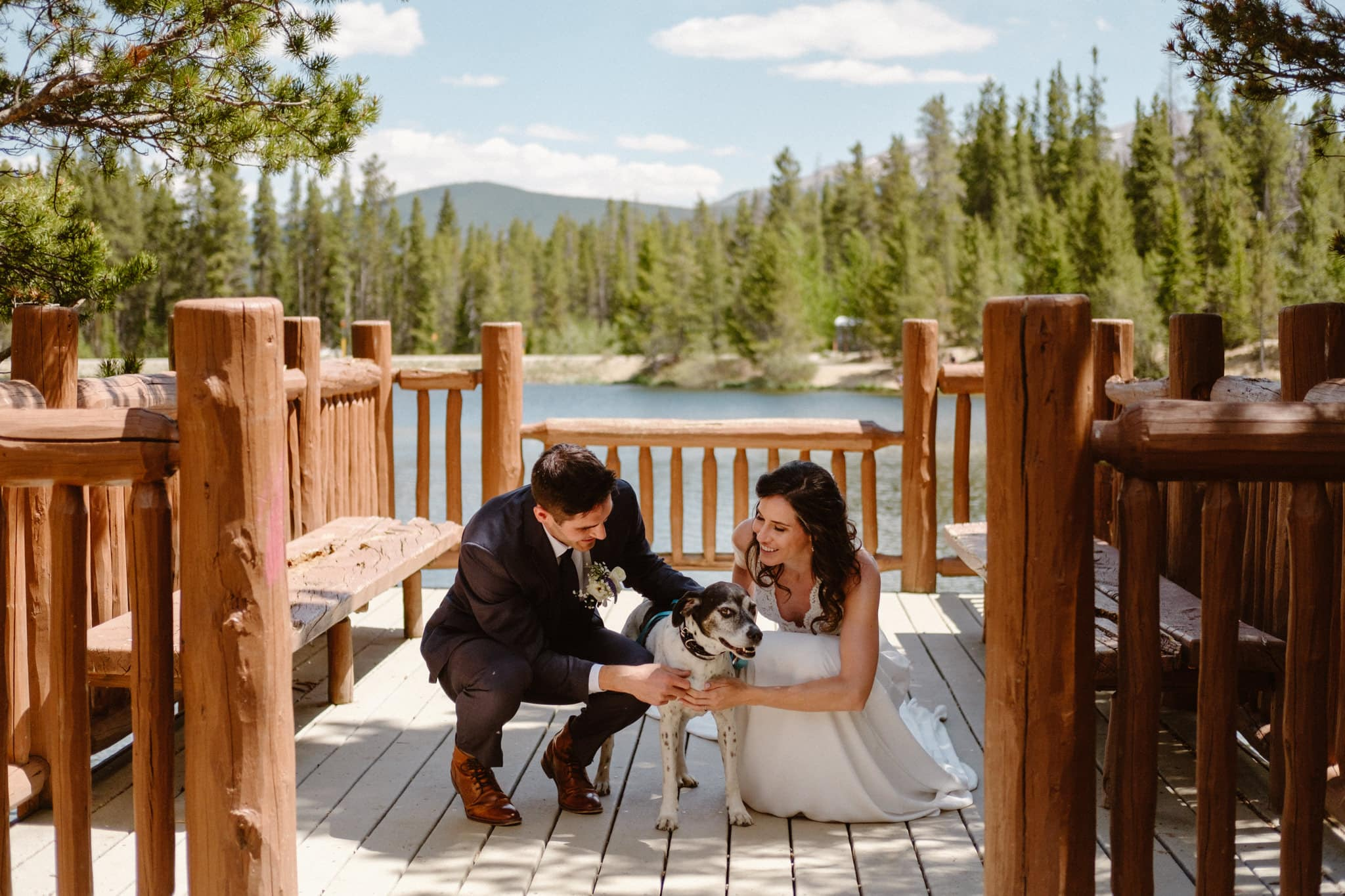Bride and groom first look with dog at Sawmill Reservoir in Breckenridge, Colorado wedding photographer