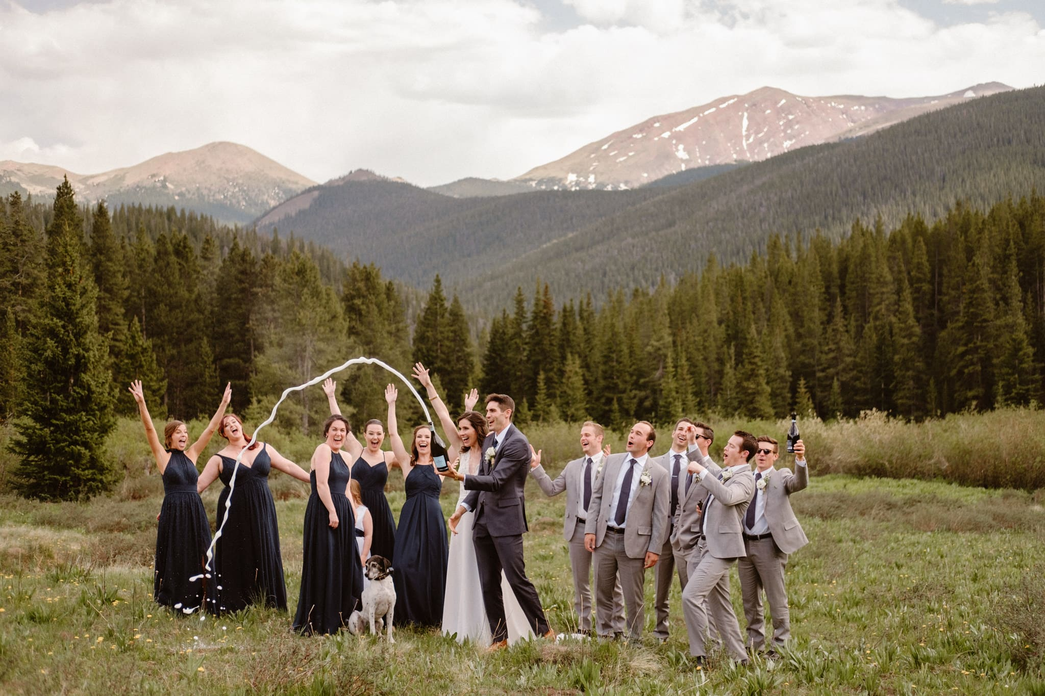 Wedding party portraits at Boreas Pass, wedding party popping champagne bottle, Breckenridge wedding photographer