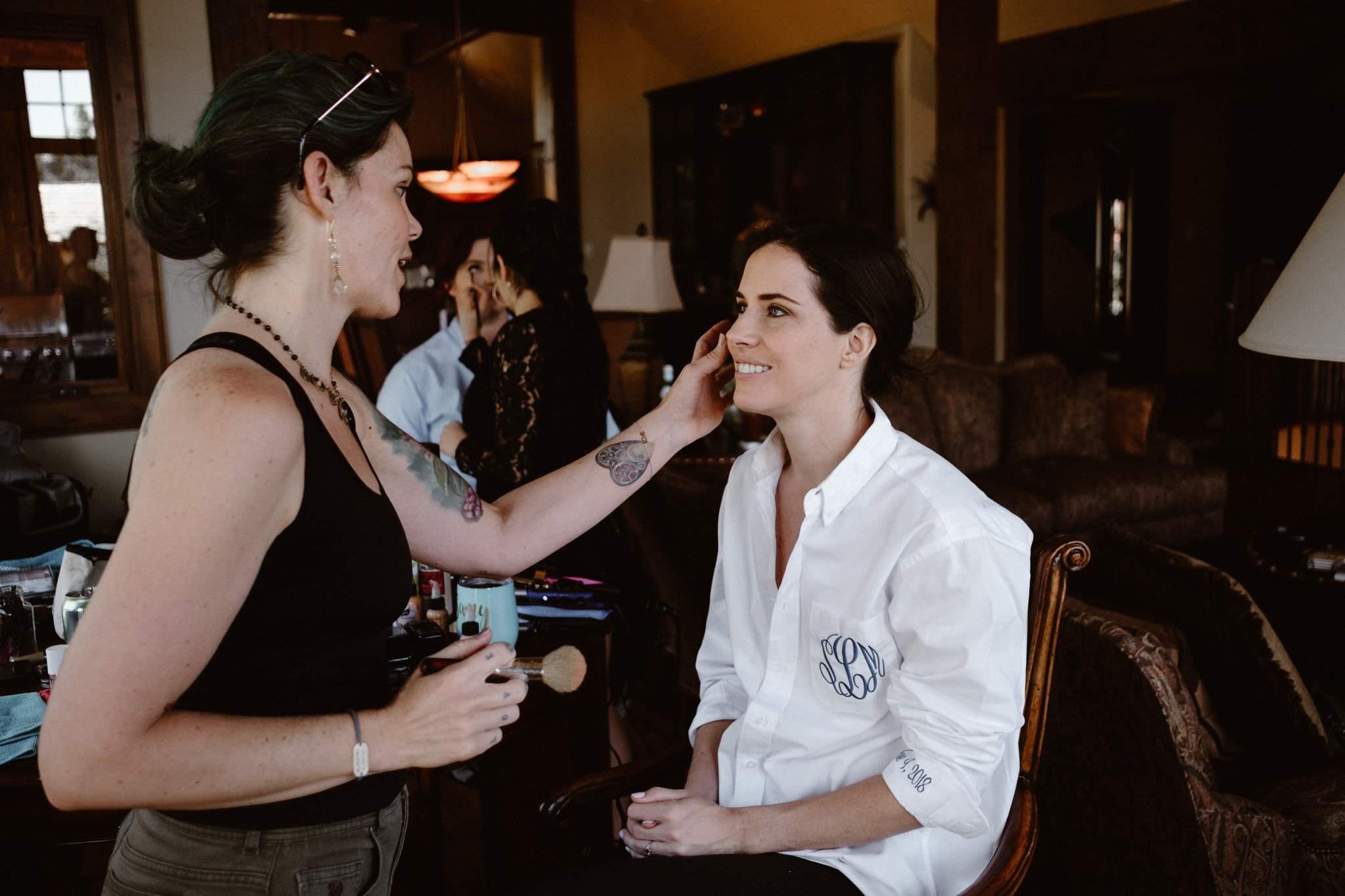 Bride getting makeup done by Wedlocks Bridal Hair and Makeup, Breckenridge wedding photographer