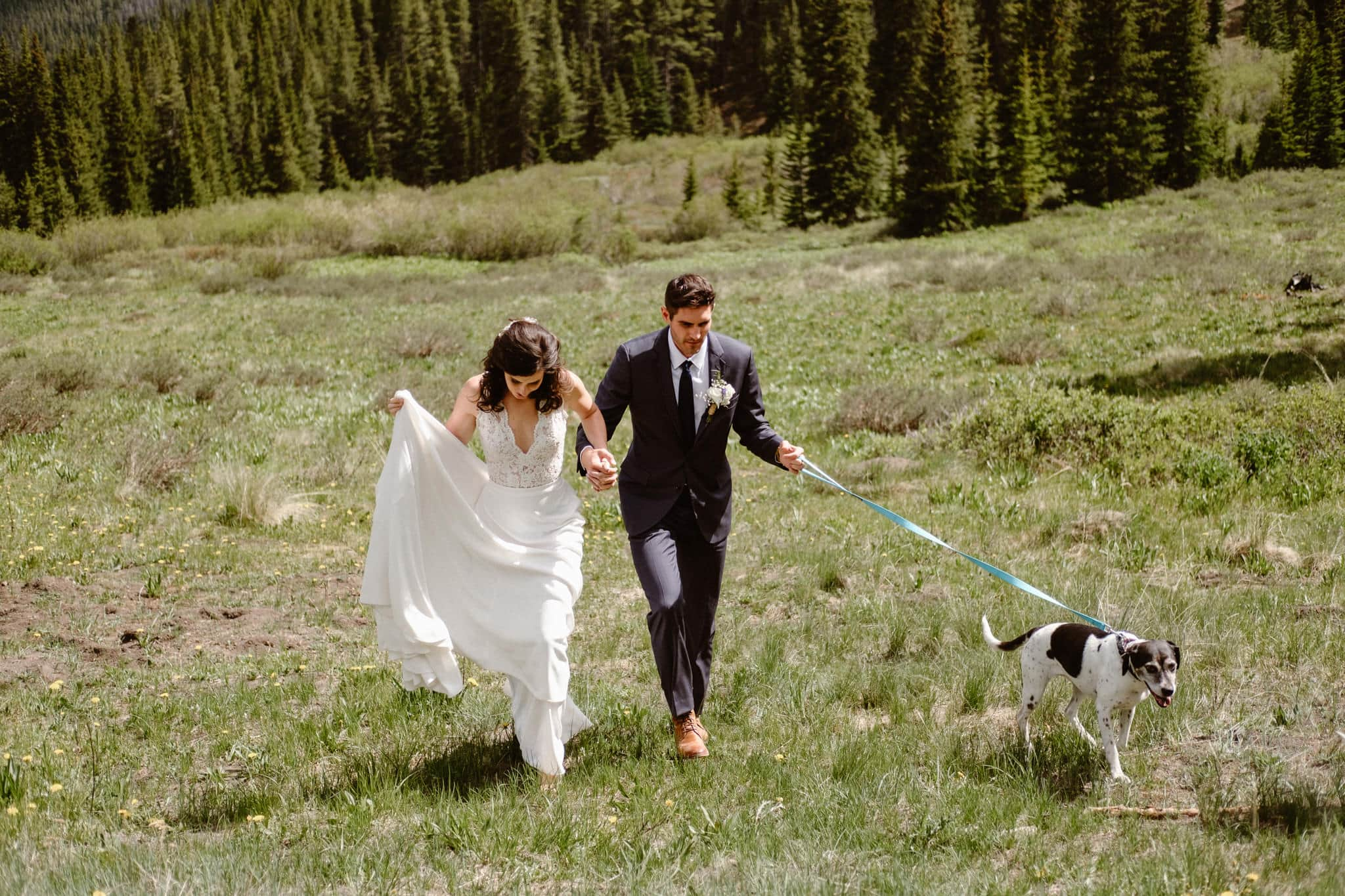 Bride and groom portraits walking their dog at Boreas Pass, Breckenridge wedding photographer, Colorado elopement photographer